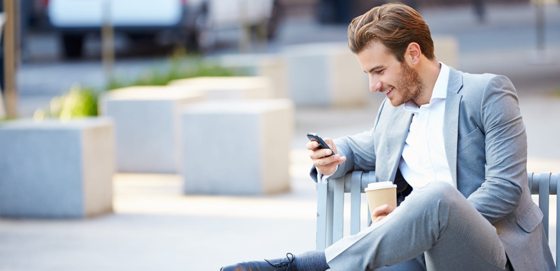 guy-in-suit-on-phone-5000x