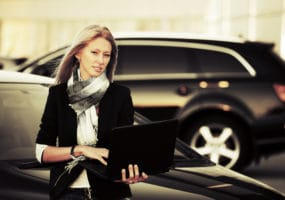 business woman with new car from Melbourne Car Broker